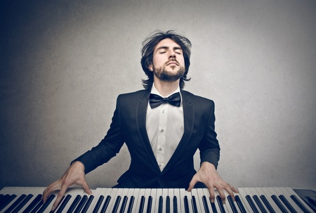 musician playing piano Stock Photo
