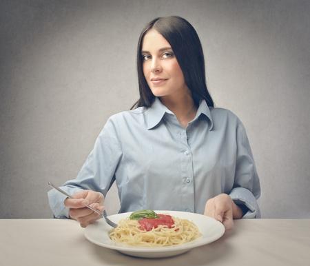 brunette woman eats spaghetti Stock Photo - 18687764