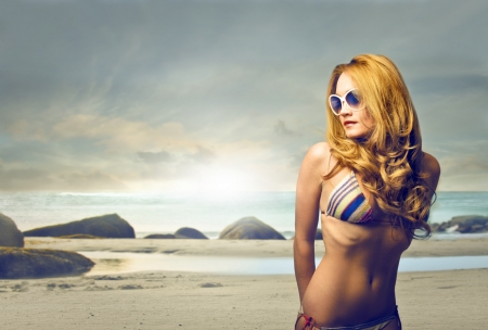 young blonde woman in bikini on the beach