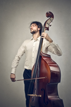 bass player: man playing the double bass Stock Photo
