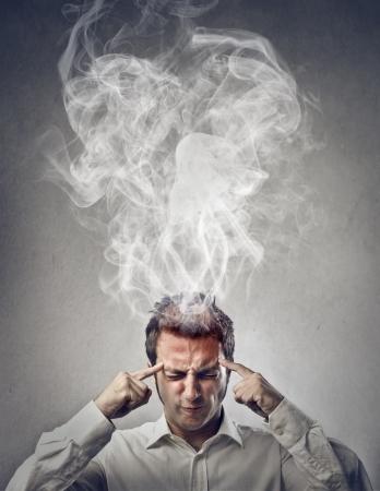intellectual: man thinking really hard  Stock Photo