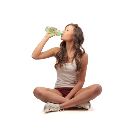 hot water bottle: woman drinking from a bottle Stock Photo