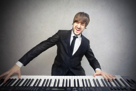 rock singer: man playing the piano Stock Photo