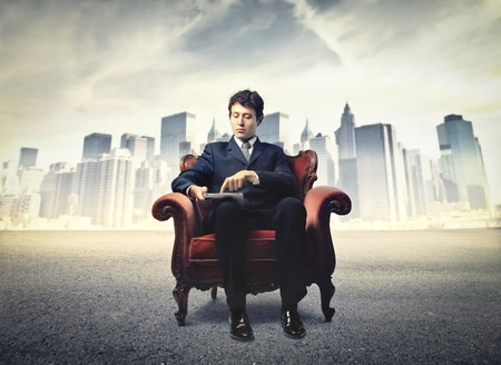 businessman sitting on an armchair photo
