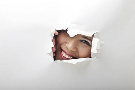 a smile from a hole Stock Photo - 19287086