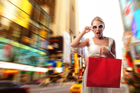 amazed woman shooping in times square photo