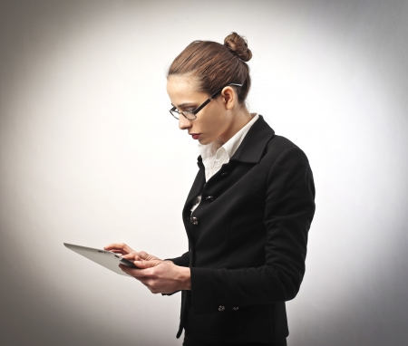 hard to find: Businesswoman working on a tablette Stock Photo