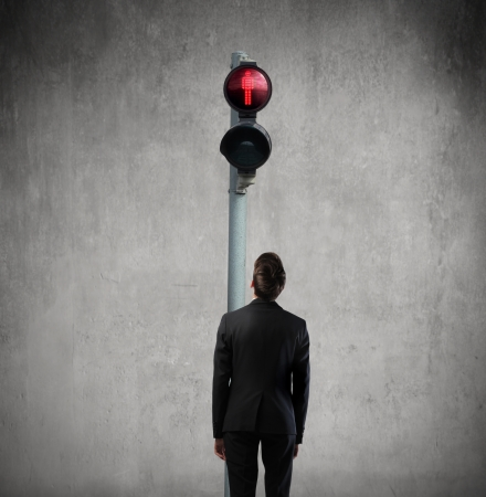 stuck: man under a traffic light  Stock Photo