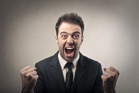 screaming face: excited businessman  Stock Photo
