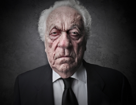 old man with a serious expression photo
