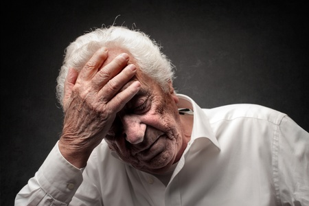 elderly pain: old man thinking Stock Photo