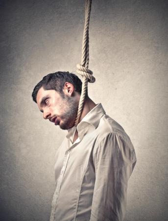 hanged: man hanging up himself