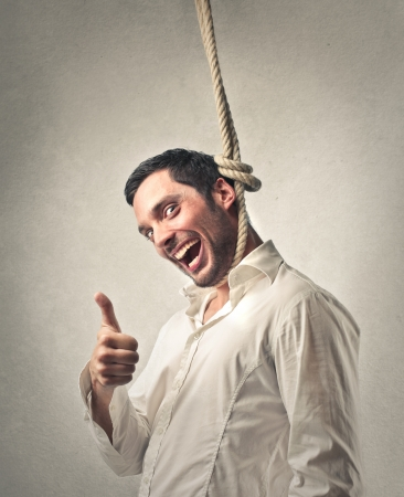optimistic: man hanging up himself with happiness Stock Photo