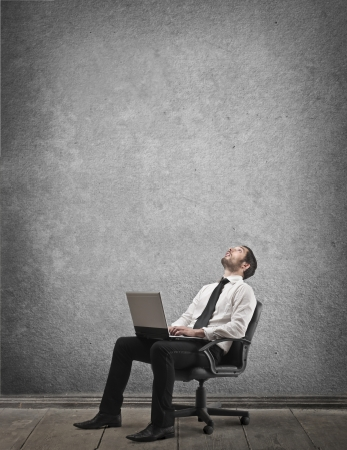 stupor: businessman sitting on a chair