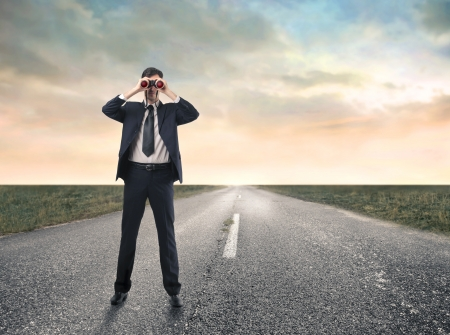 binocular: businessman looking at something with a binoculars Stock Photo