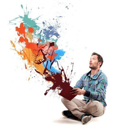 man opening a book and coming out paint photo