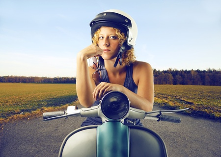 woman on a vespa photo