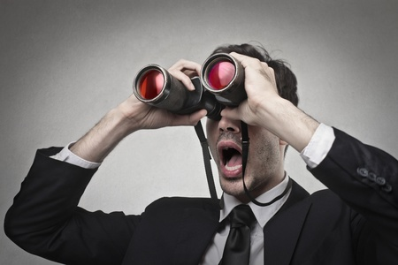 businessman looking at something with a binoculars Stock Photo