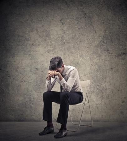 despair: desperate businessman on a chair Stock Photo