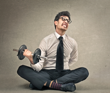 work hard: businessman with a weight