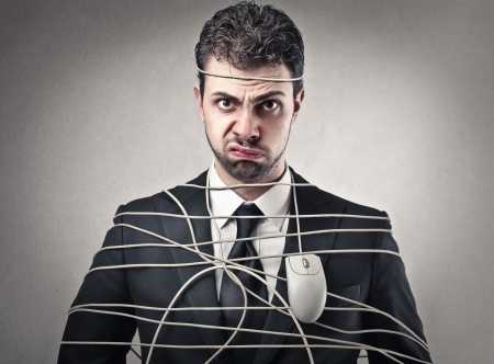annoying: businessman wrapped up with a mouse Stock Photo