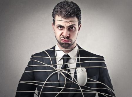 molesto: empresario envuelto con un ratón