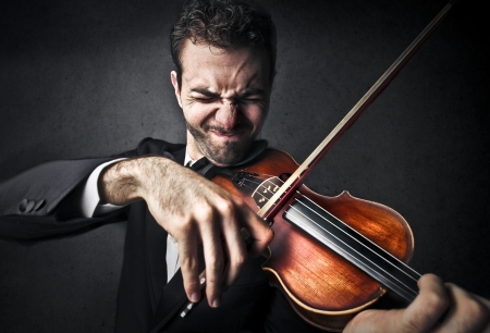 man trying to play the violin