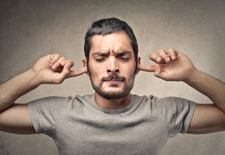 vexation: man with fingers in his ears