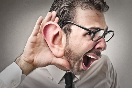 man trying to hear with a huge ear photo