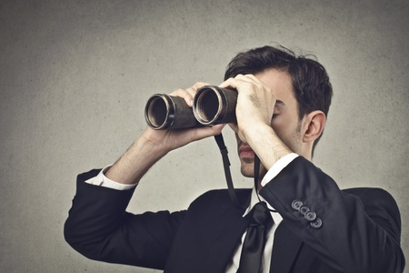 stupor: businessman looking through a binoculars