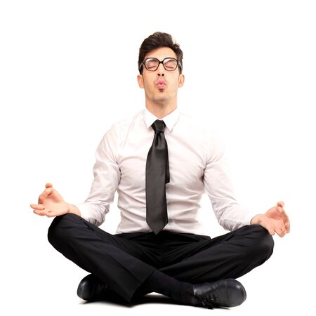 businessman doing yoga Stock Photo