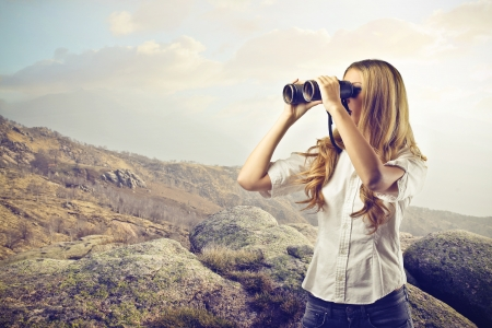 binoculars: woman looking at something with a binoculars
