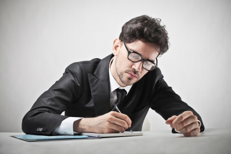 concetrated: concetrated businessman writing Stock Photo