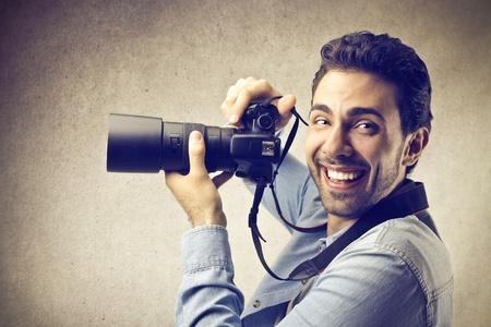 man smiling using a camera photo