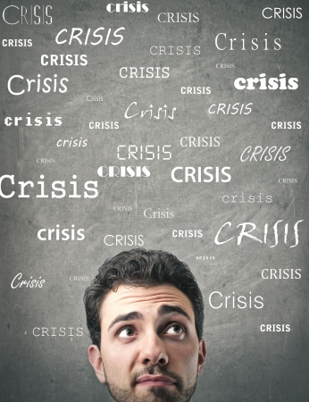 downhearted: worried man thinking about the crisis