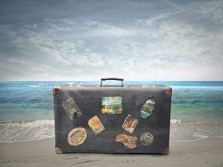 seashore: suitcase close to the sea