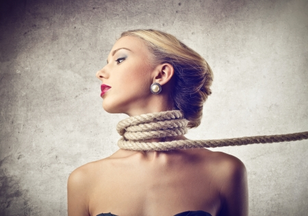 woman neck: beautiful woman with a rope around her neck