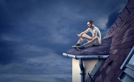 man on the roof of a house Stock Photo - 21802972