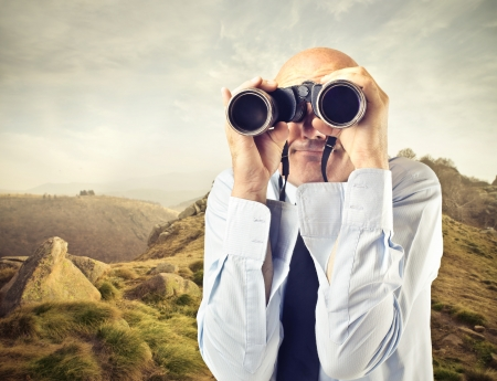 mirage: businessman looking through a binoculars