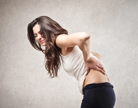 aching muscles: young woman with backache
