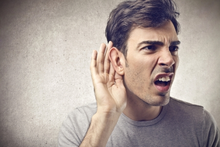 stupor: man trying to hear something