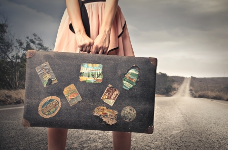 woman ready to leave with her suitcase Stock Photo