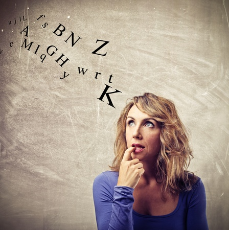 woman thinking about some letters Stock Photo - 22776159