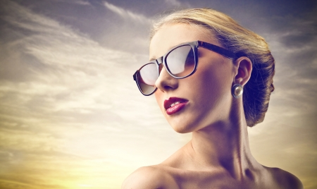 beautiful young woman wearing sunglasses photo