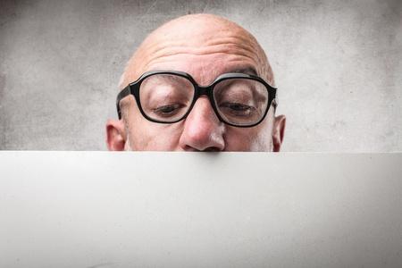cartel: businessman hiding behind a paper Stock Photo