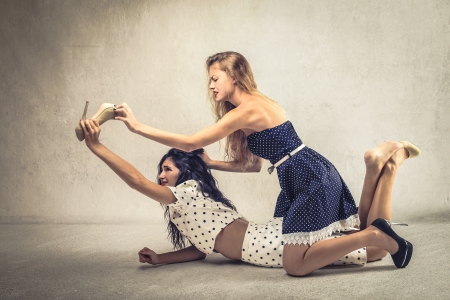 women fighting: two women fighting for a shoe