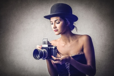 beautiful young woman with a camera photo