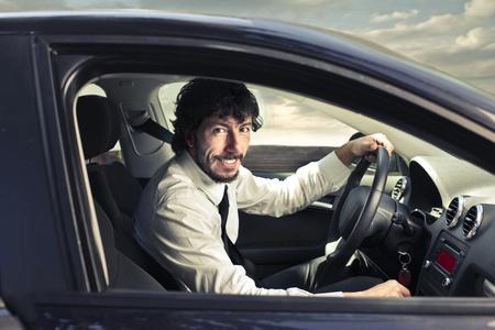 businessman driving a car photo