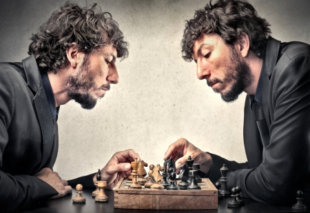 man playing chess with himself Stock Photo