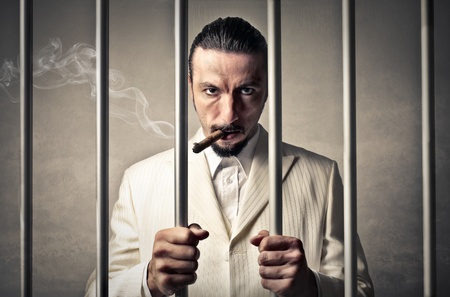 gangsters: rich boss man into jail  Stock Photo